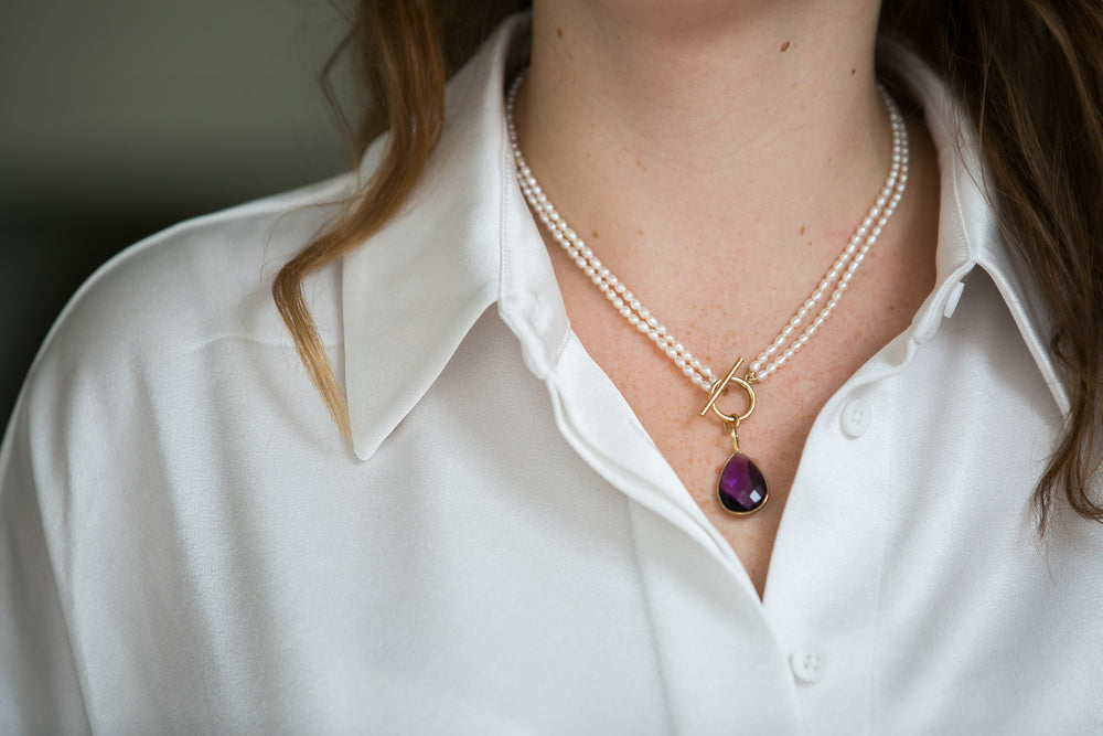 Clara double-strand cultured freshwater pearl necklace with amethyst drop pendant