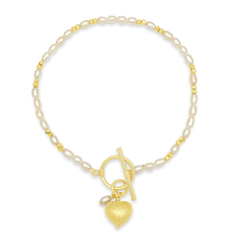 White cultured freshwater pearl bracelet with gold beads & a gold heart charm