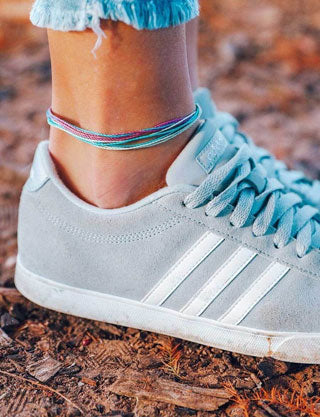 Dainty string anklets in rainbow colors