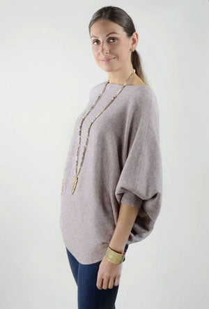 A woman models a lavender Dolman sweater as an example of a spring work outfit idea