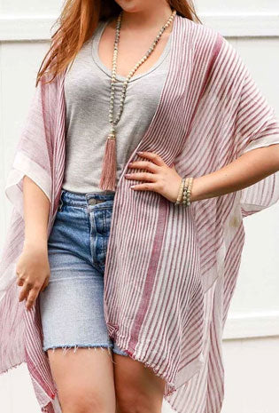 Woman models stripped pink kimono as a cute summer look
