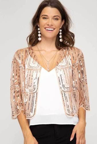 A see-through rose-gold bolero jacket