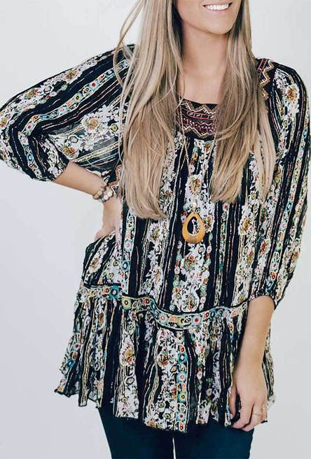 A brightly patterned tunic shirt