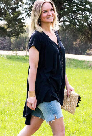 Woman models the new Free People black shirt