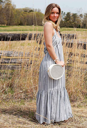 Woman models the new Free People striped maxi dress