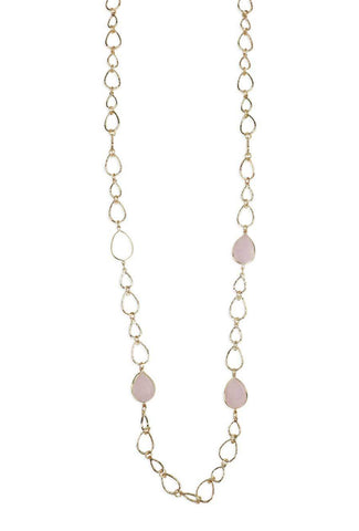 Stylish, gold necklace accessory with pink stones.