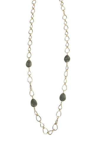 Stylish, gold necklace accessory with black stones.