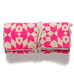 Jewelry snug in hot pink geometric print.
