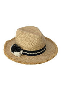 Straw hat with black and white pom poms