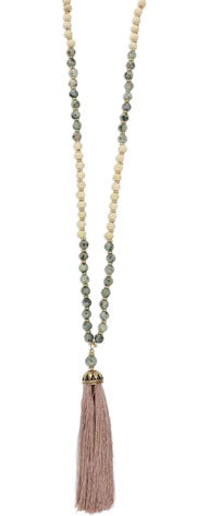 Long, tassel necklace with white and green beads