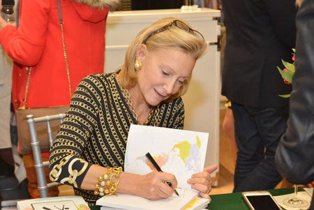 Author Karen Klopp signs her book during an event