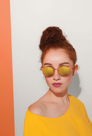 Woman models her sunglasses as part of her festival accessories