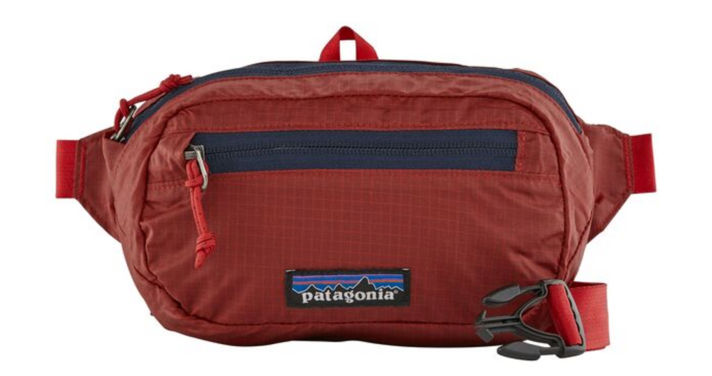 The Patagonia Ultralight Black Hole® Mini Hip Pack 1L - Rincon Red Women's Backpacks from Patagonia at Shop Southern Roots TX