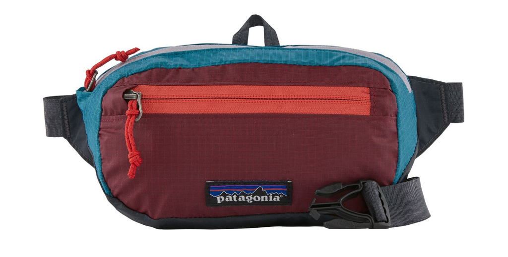 The Patagonia Ultralight Black Hole® Mini Hip Pack 1L - Patchwork: Roamer Red Women's Backpacks from Patagonia at Shop Southern Roots TX