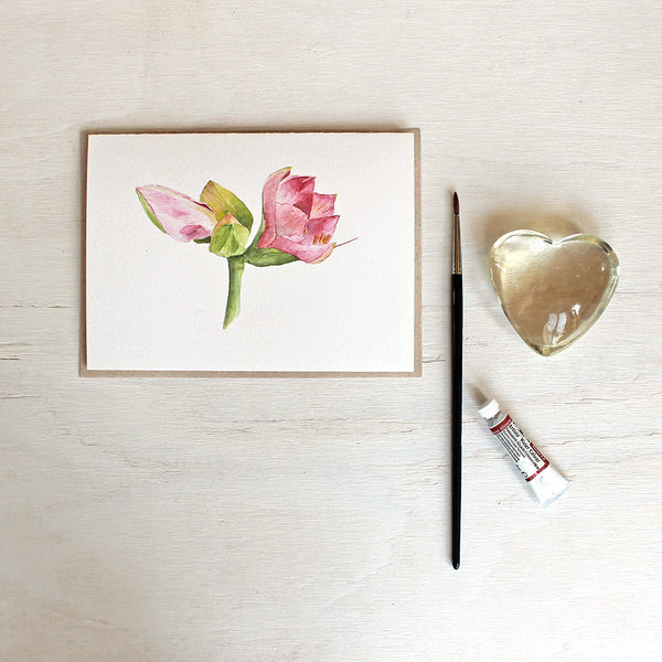 Note card with a watercolour painting of pink amaryllis flowers. Artist Kathleen Maunder.