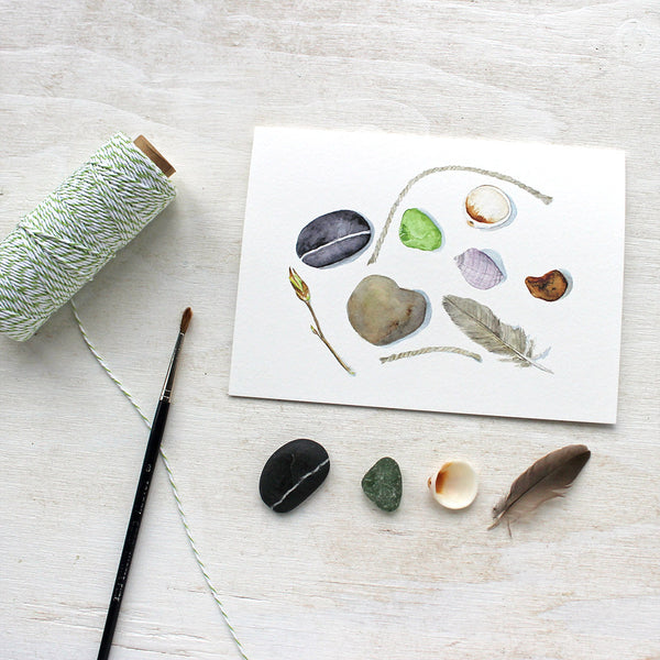 Beach collection note cards by watercolor artist Kathleen Maunder featuring shells, stones, a feather and sea glass.