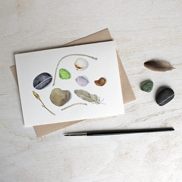 Note cards featuring a feather, shells, stones and sea glass painted in watercolor by Kathleen Maunder