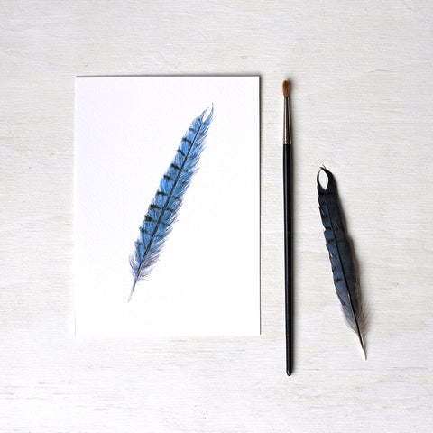 Art print featuring an original watercolor painting of a blue jay feather by Kathleen Maunder.