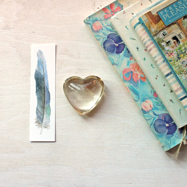 Blue feather bookmark featuring a watercolour by Kathleen Maunder