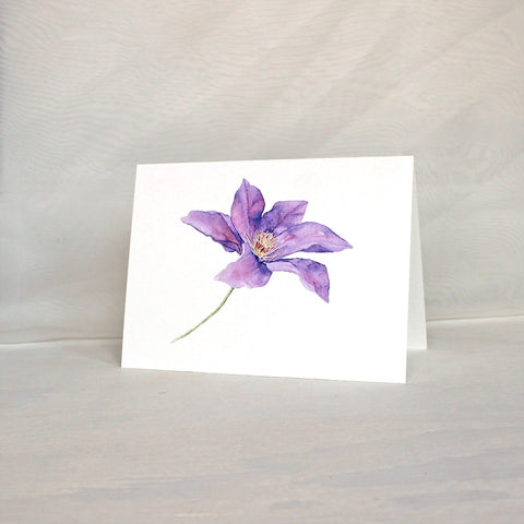 Note card featuring watercolor painting of a purple clematis flower. Artist Kathleen Maunder.
