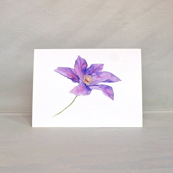 Purple clematis flower watercolor painting on a note card. Artist Kathleen Maunder.
