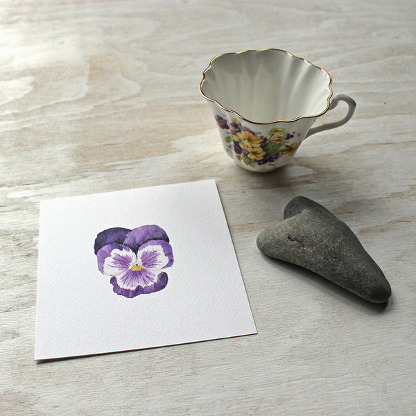 Print of a dark purple pansy by watercolor artist Kathleen Maunder of Trowel and Paintbrush