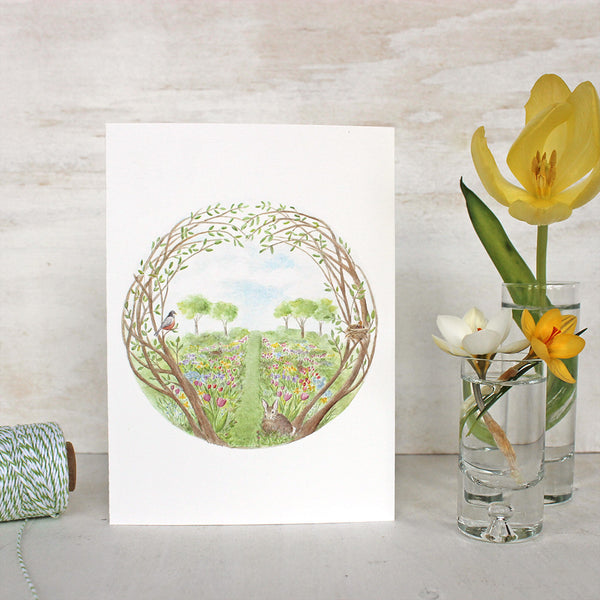 Secret Garden Note Card by watercolor artist Kathleen Maunder. A garden full of spring flowers, baby birds and bunnies.