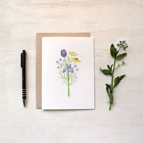 Note card featuring a bouquet called 'Flowers for Change', inspired by the Black Lives Matter movement. The bouquet contains a black tulip, dill, borage, black-eyed Susan, blue iris, thyme and forget me nots, all chosen for their meaning. Watercolour artist - Kathleen Maunder.