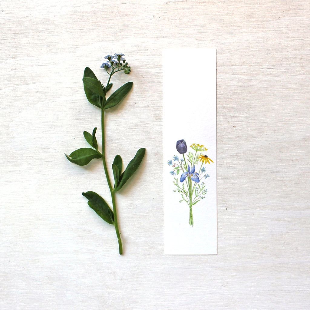 Flowers for Change paper bookmark featuring a watercolor painting by artist Kathleen Maunder