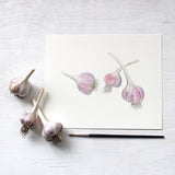 Watercolor painting of three garlic bulbs - Artist Kathleen Maunder - Available as print from Trowel and Paintbrush