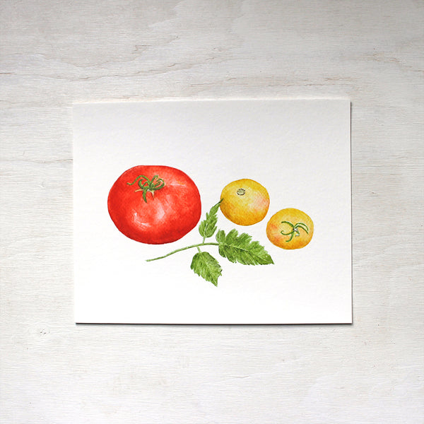 An art print with a red Beefsteak tomato and two yellow Garden Peach tomatoes. Painted in watercolor by Kathleen Maunder.