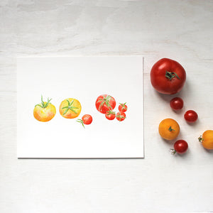 A watercolor art print depicting a grouping of small yellow and red heirloom tomatoes. Artist Kathleen Maunder.