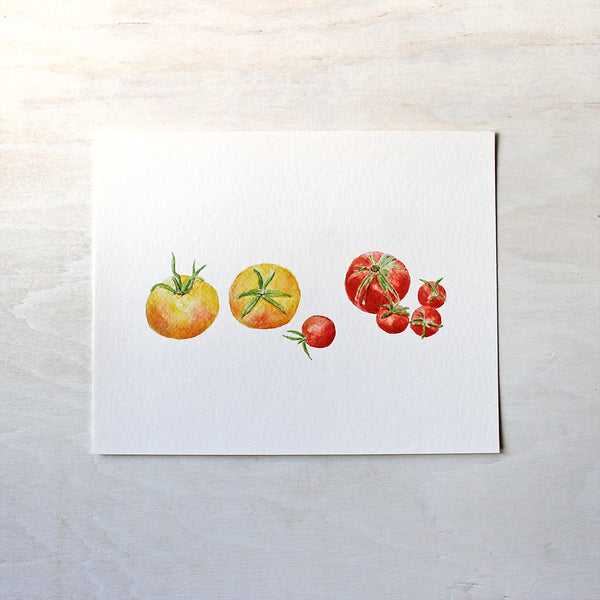 A watercolor art print of seven small yellow and red heirloom tomatoes. Artist Kathleen Maunder.