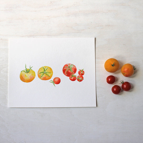An art print of seven small yellow and red heirloom tomatoes by watercolor artist Kathleen Maunder.