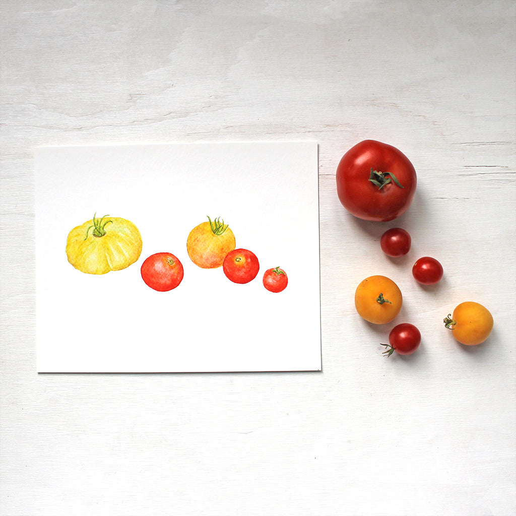 A watercolor art print depicting a grouping  of red and yellow heirloom tomatoes. Artist Kathleen Maunder.