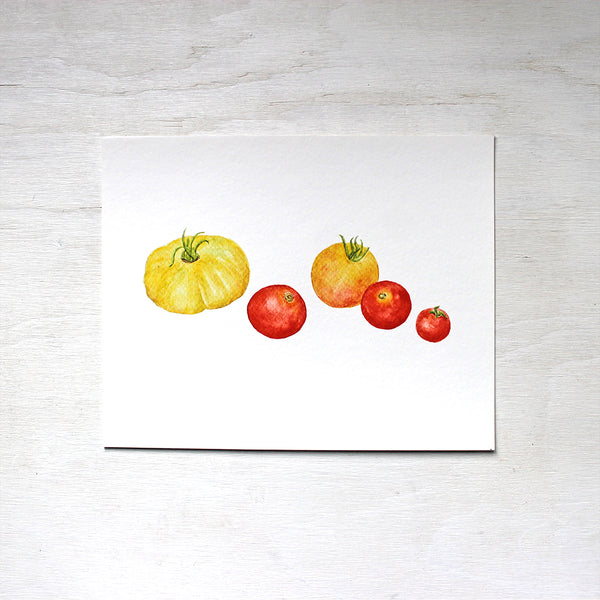 An art print of yellow and red heirloom tomatoes by watercolor artist Kathleen Maunder.