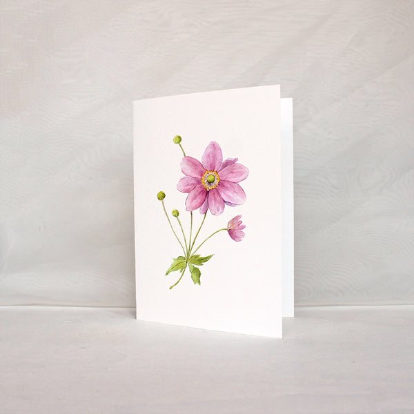 Note card featuring a pink Japanese anemone flower in watercolour. Artist Kathleen Maunder.