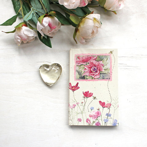 Vintage hardcover journal with ruled pages. The floral watercolor paintings on the cover are by Kathleen Maunder.