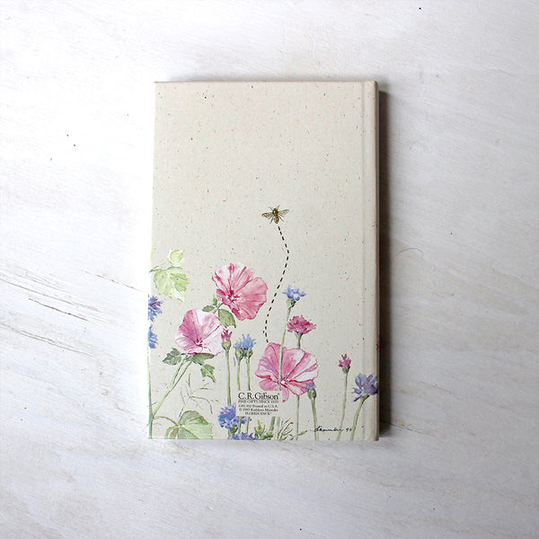 Back cover of journal with ruled pages. The floral watercolor paintings on the cover are by Kathleen Maunder.