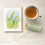 Blank note cards featuring a lily of the valley watercolor painting by Kathleen Maunder