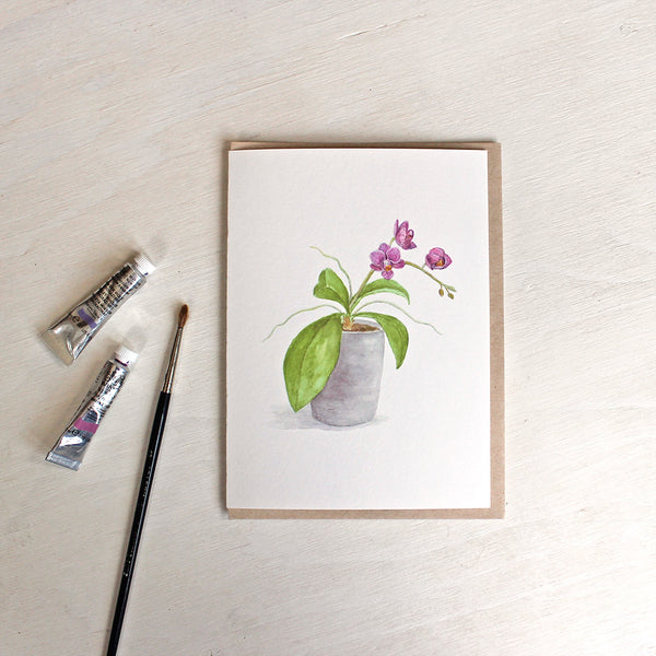 Note card and kraft envelope. Card features a watercolour painting of a pot of tiny magenta orchids. Artist Kathleen Maunder.
