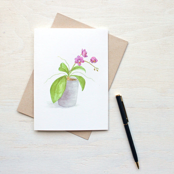Note card featuring a watercolor painting of a pot of tiny magenta orchids by artist Kathleen Maunder.