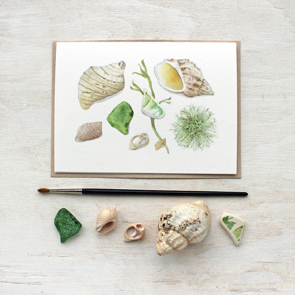 Beach finds note cards by watercolor artist Kathleen Maunder featuring shells, beach glass and seaweed.