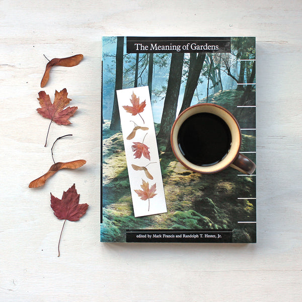 Bookmark featuring a watercolor painting of maples leaves and keys by artist Kathleen Maunder