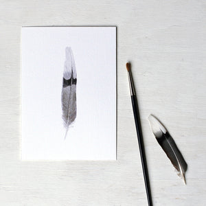 Art print of a watercolor painting of a mourning dove feather. Artist Kathleen Maunder.