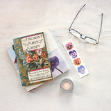 Bookmark featuring watercolour paintings of four pansies by artist Kathleen Maunder