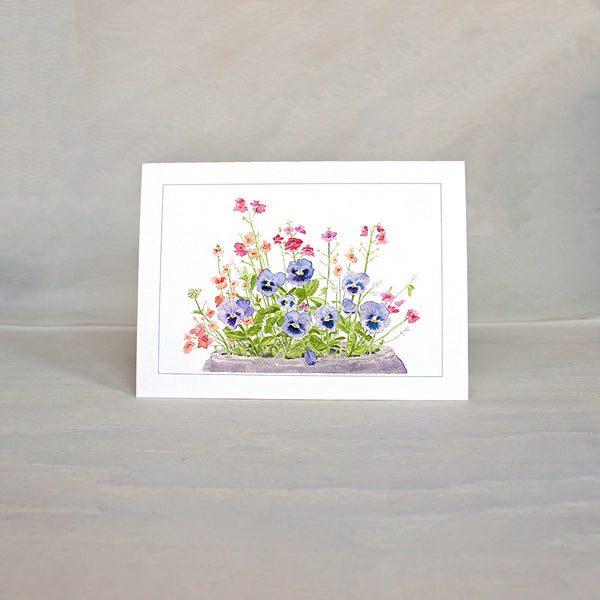Note card featuring purple blue pansies in a pot. Watercolour painting by Kathleen Maunder