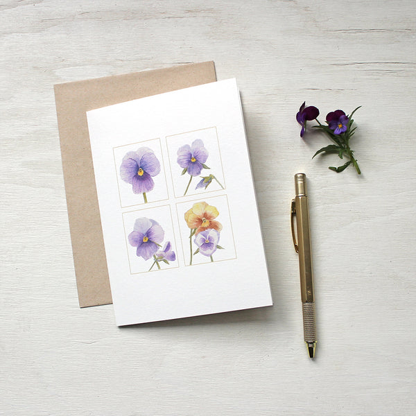 Four purple and gold pansy images painted in watercolor and featured on notecards. Artist Kathleen Maunder.