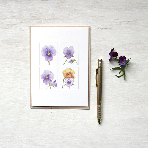 A quartet of pansy images painted in watercolour and featured on notecards. Artist Kathleen Maunder.
