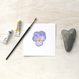 Print of a lavender colored pansy by watercolor artist Kathleen Maunder, trowelandpaintbrush